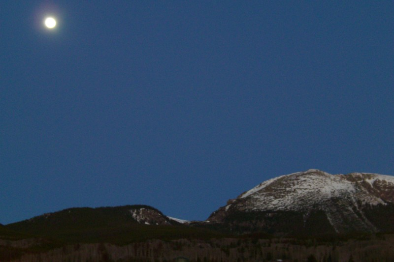 Full Moon at Sunrise over the mountains in Frisco, CO