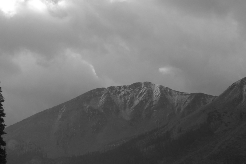 Black & White pic of sunny peak among clouds, from Independence Pass