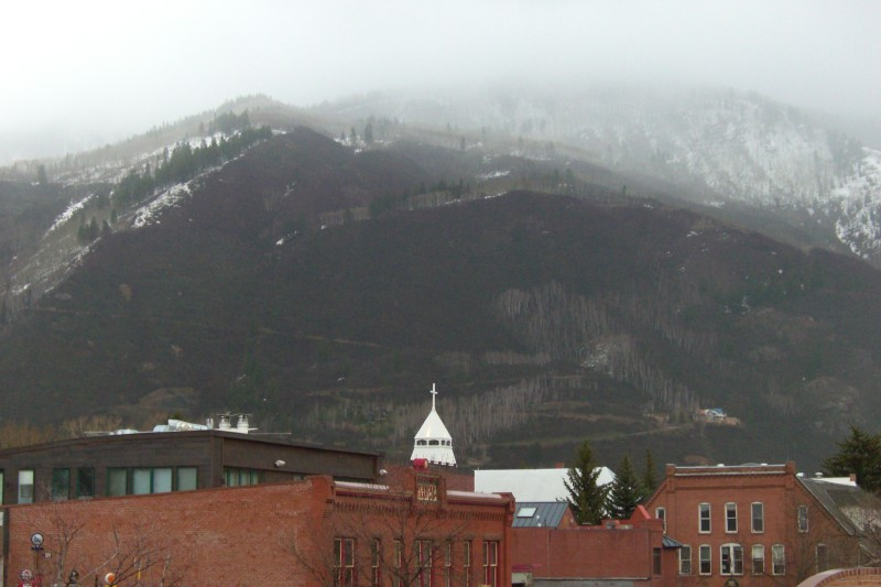 St. Mary's Church, City Hall, with late spring snow and cloud on Smuggler Mtn.