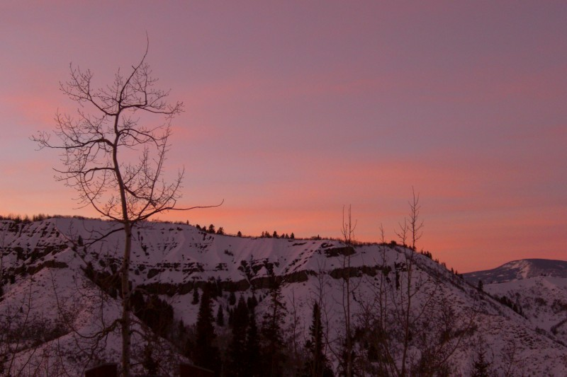 colorful sunset from the deck at Lykins place in Snowmass