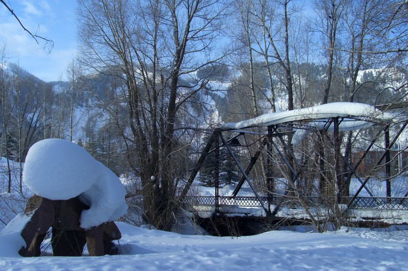 Snow accumulates on a sculpture by the Aspen Art Museum and on the Rio Grande Bridge.