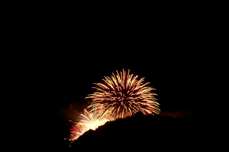 Fireworks for the Food & Wine Classic illuminate the ridge of Shadow Mountain.