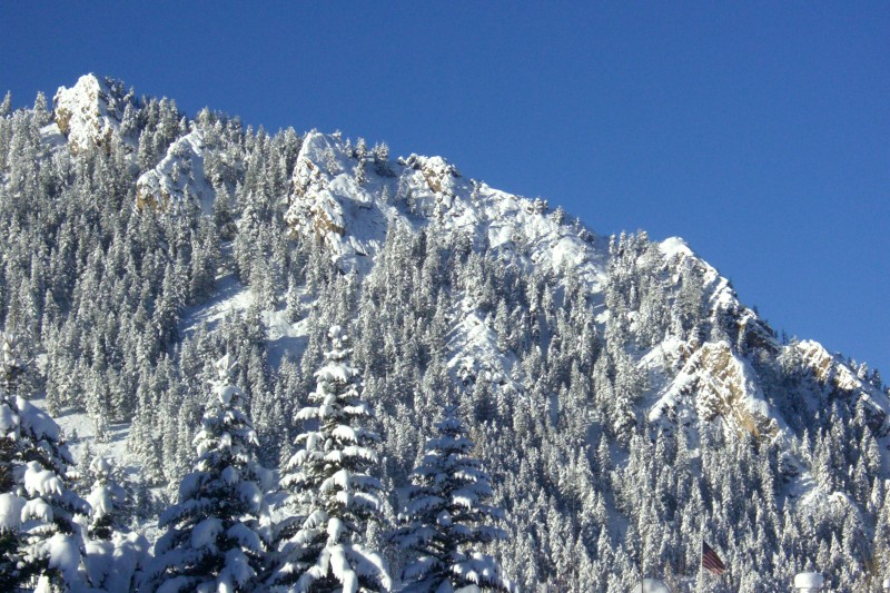 Snowy Shadow Mountain, with bright blue skies overhead.