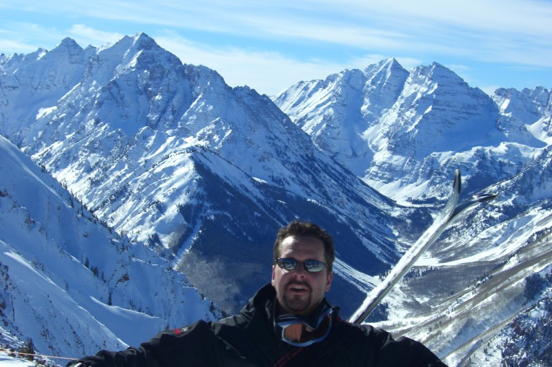 Near the top of the Highland Bowl, with Pyramid Peak and the Maroon Bells behind.